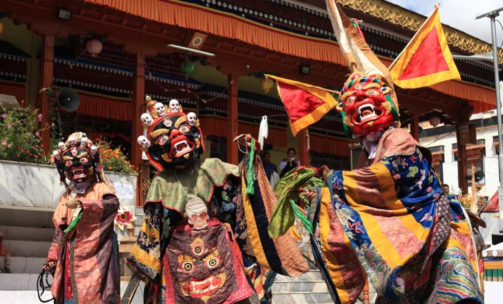 Dancing in Masks and costumes at the Losar festival