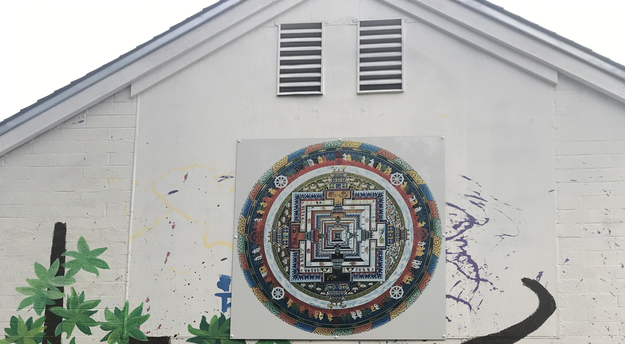 the Kalachakra Mandala vynyl reproduction is positioned at the center of the coming mural