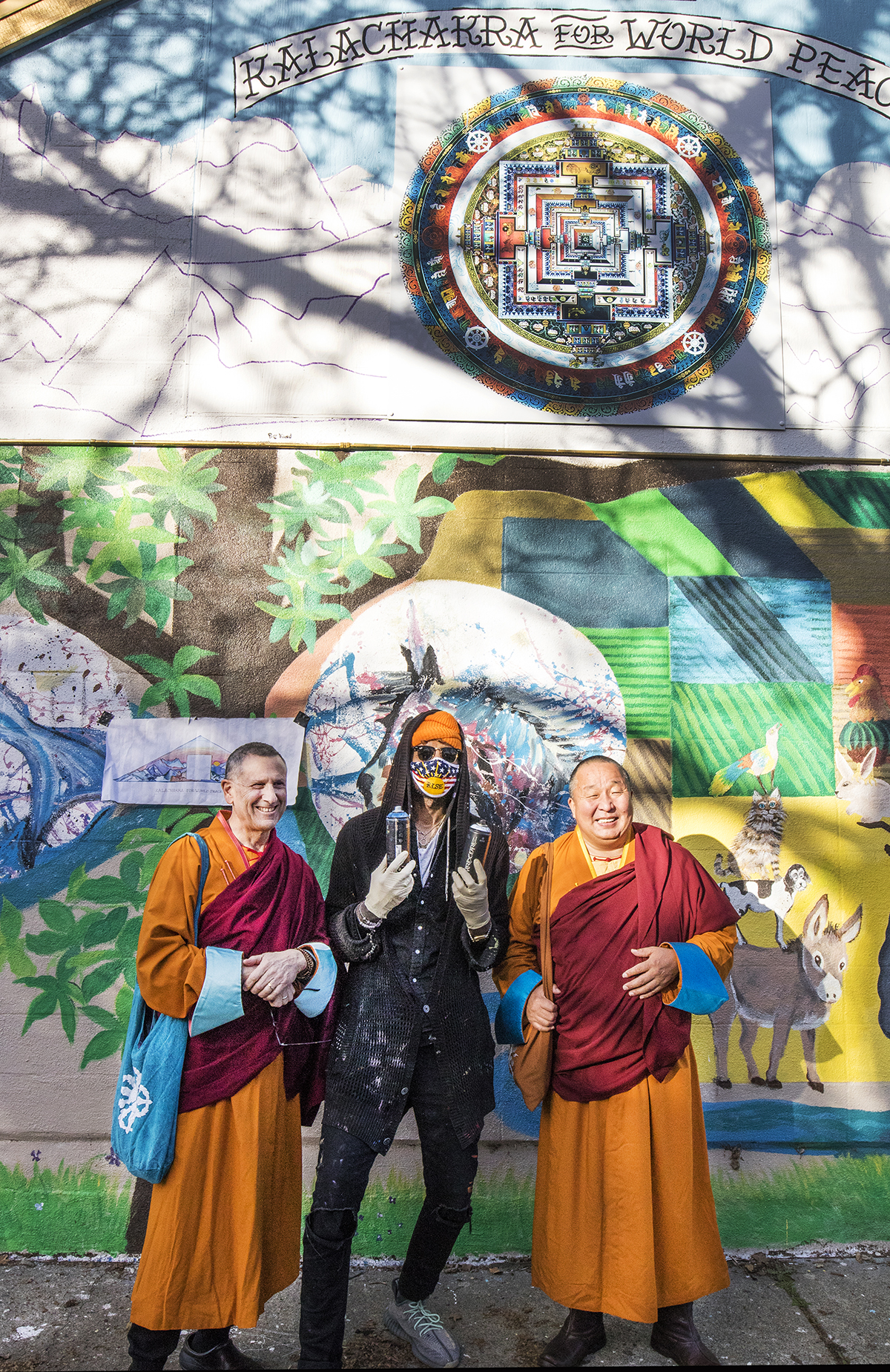 Geshe Damchoebaazar Gurjav in front of the mural and Kalachakra mandala during Losar 2021 celebrations at Do Nga Dargey temple sacramento california
