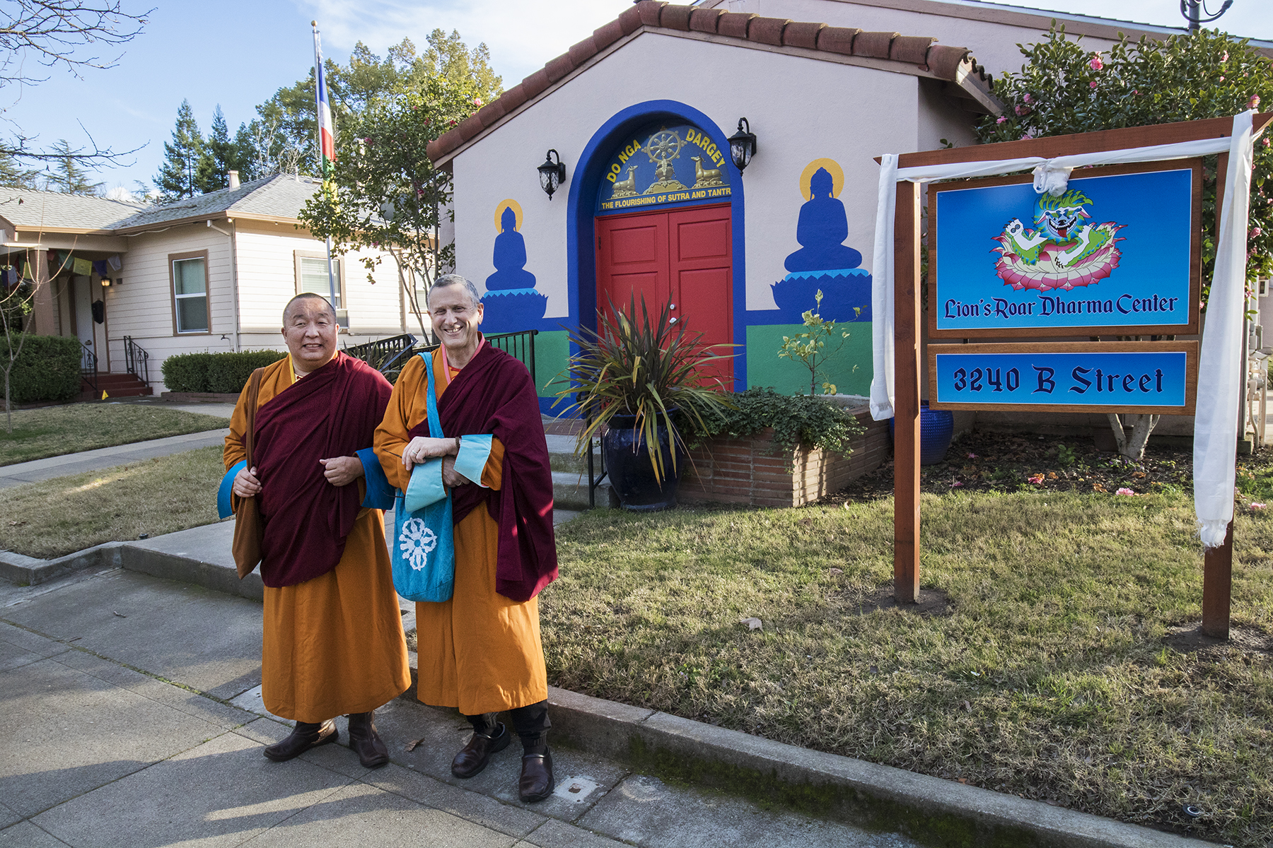 Lama Yeshe Jinpa and Geshe Damchoebaazar Gurjav in front of Do Nga Dargey temple, Sacramento, california and the new sign