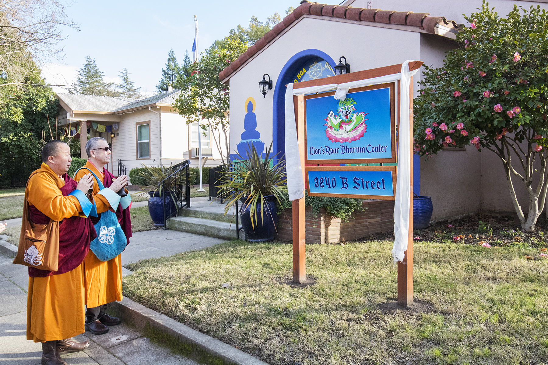 Lama Yeshe Jinpa and Geshe Damchoebaazar Gurjav perform a blessing ceremony for the new sign at do nga dargey temole on Losar 2021 year of the iron ox 2148 in sacramento california