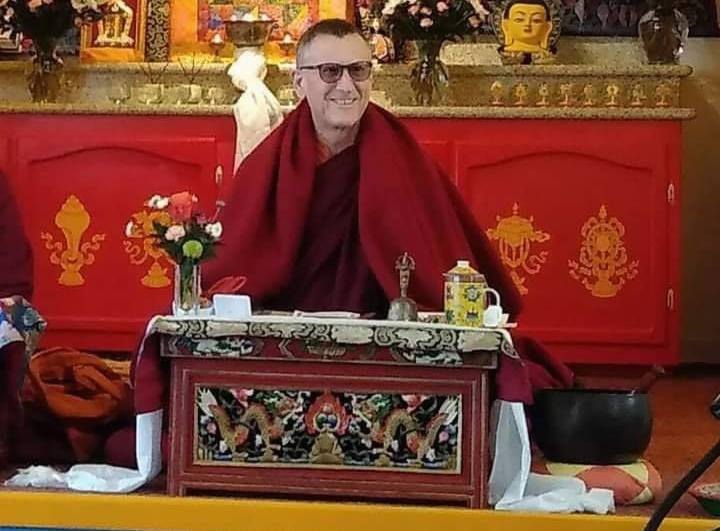 Lama Yeshe Jinpa seated at puja table in Do Nga Dargey Temple Sacramento, CA